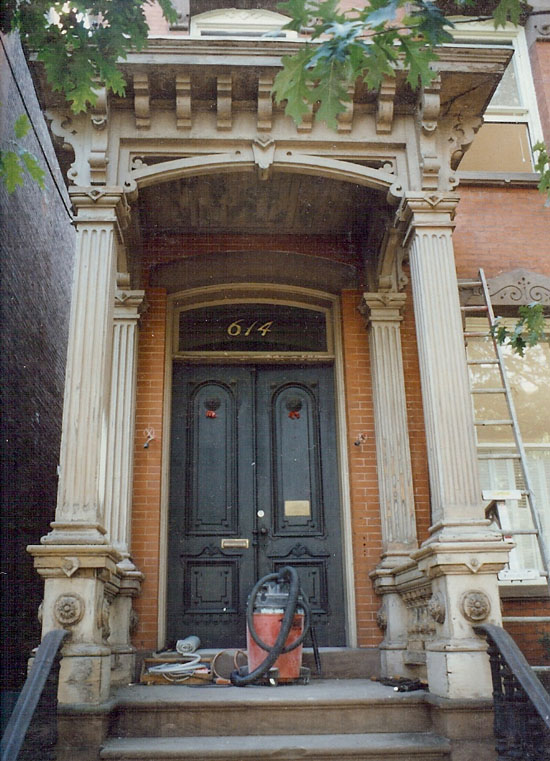 This stoop is an excellent example of late Victorian city residence entryway, featuring such generous Italianate details as the robust balusters featured in this portico balustrade.